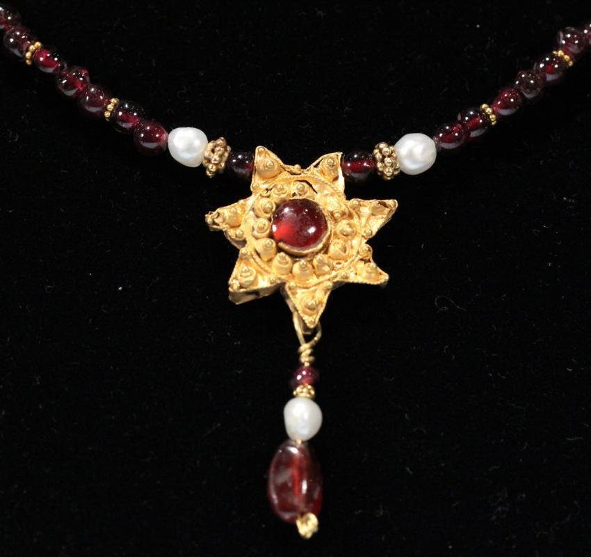 Fatimid Gold Star with Garnet Pendant Necklace